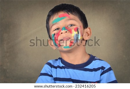 kid playing with paint - stock photo