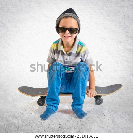 Kid playing with skateboard