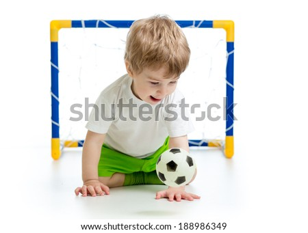 kid playing with soccer ball - stock photo
