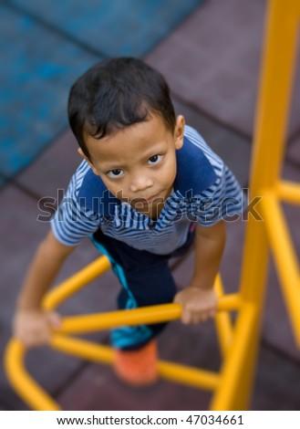 Kid plays at playground. - stock photo