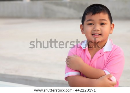 Kid portrait smiling and cross one's arm  - Asia children  - stock photo