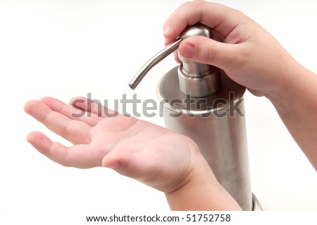 Kid pouring alcohol-based sanitizer himself. Isolated on white. - stock photo