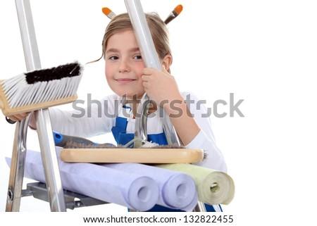 Kid pretending to decorate - stock photo