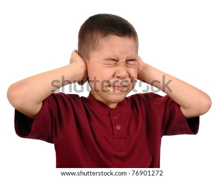 kid protecting ears from loud noise, isolated on white background - stock photo