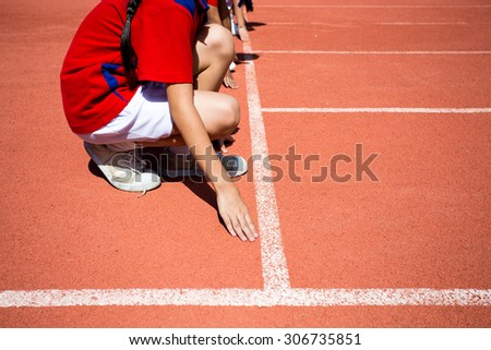 Kid runing on track in the Stadium