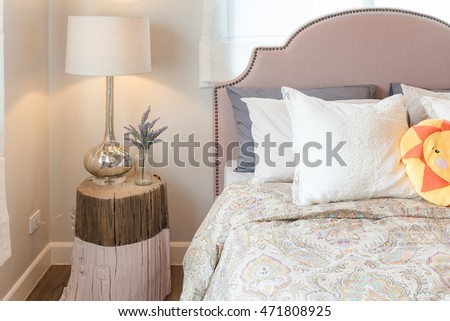 kid's bedroom design with colorful dolls and set of pillows on bed