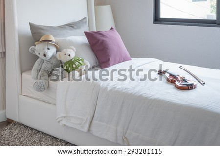 kid's bedroom with dolls and pillow on bed at home - stock photo