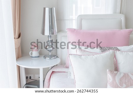 kid's bedroom with lamp on round table in pink color style at home - stock photo