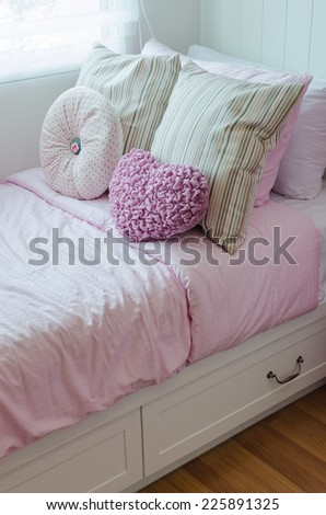 kid's bedroom with pink bed at home - stock photo