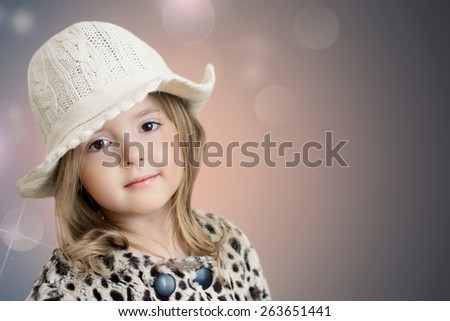 Kid's fashion background. Beautiful little girl in hat closeup.