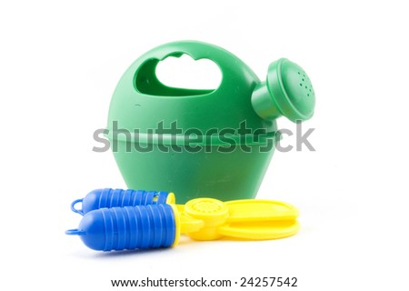 kid's garden toys isolated on white - stock photo
