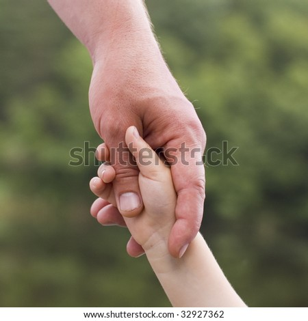 kid's hand in father's hand