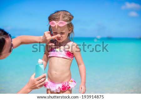 Kid's protection sun cream - stock photo