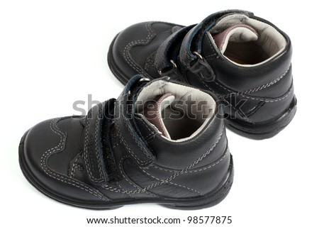 kid's shoes from the black leather isolated on white background - stock photo