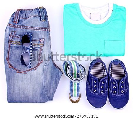 Kid's street casual outfit on white background. Overhead view. Teen's concept. Partly isolated with a shadows.