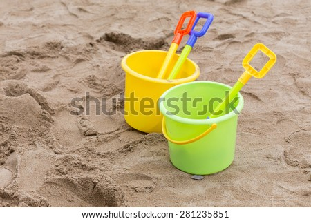 kid's toys for playing sand bucket and shovel in playground, enjoy with activity of family - stock photo