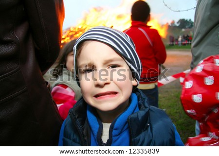 Kid scared from fire - stock photo