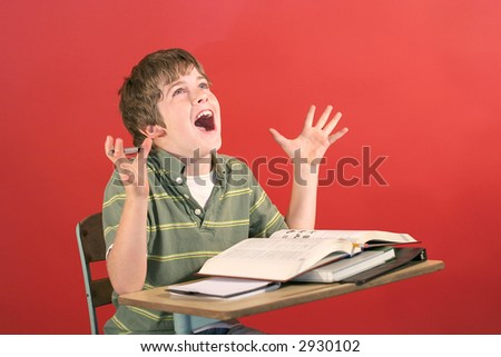 kid screaming at desk - stock photo