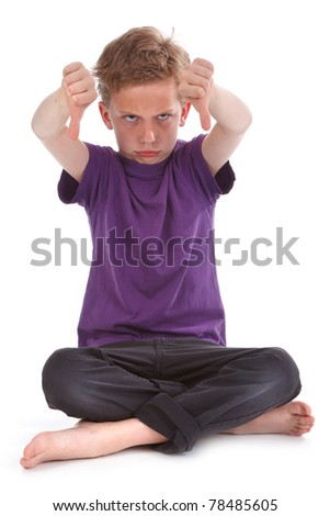 kid showing thum down, against white background - stock photo