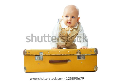 Kid sit on the big vintage suitcase isolated on white background - stock photo