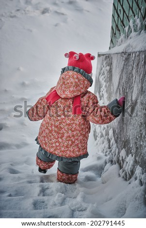 Kid snow swept down the stairs. - stock photo