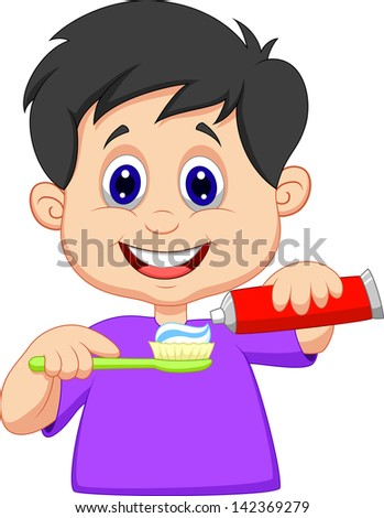 Kid squeezing tooth paste on a toothbrush - stock photo