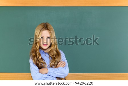 kid student girl on green blackboard posing with smile