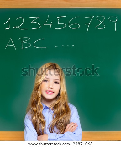 kid student girl on green school blackboard and chalk written letters and numbers
