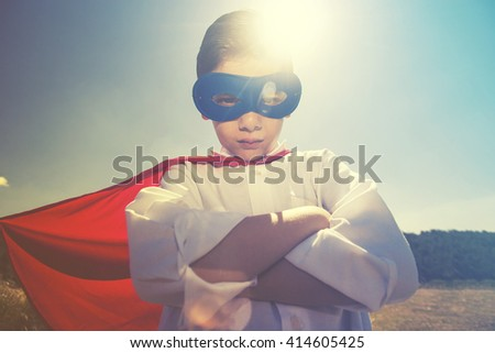 Kid superhero concept. Retro toned image with selective focus - stock photo