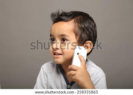Kid talking on mobile - stock photo