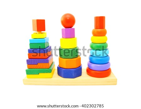 Kid toy. Learning child wood color pyramid toy on white background - stock photo