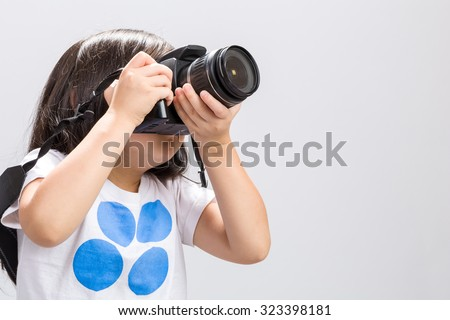 Kid Using Camera DSLR, Studio Shot