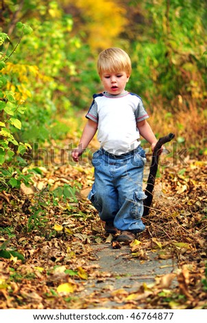 kid walking in the fall park - stock photo
