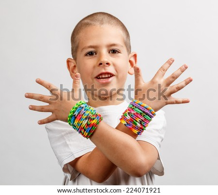 Kid wearing loom band bracelets