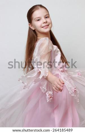 Kid wearing pink dress as a princess - stock photo