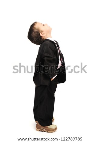 Kid wearing suit isolated looking up - stock photo