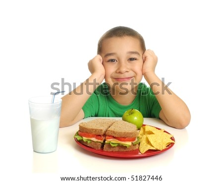 Kid with a healthy sandwich meal, isolated on white - stock photo