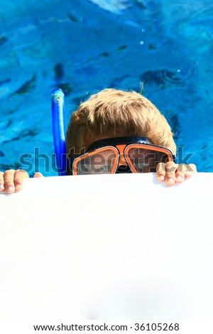 kid with a snorkeling mask showing only eyes - stock photo