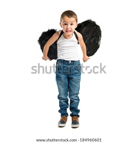 Kid with black wings over white background