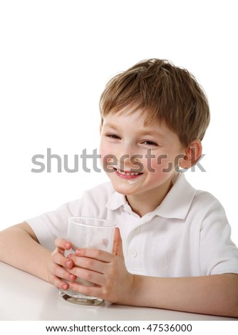 Kid with glass of milk - stock photo