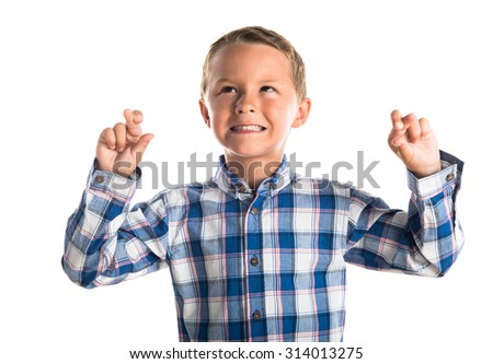 Kid with his fingers crossing   - stock photo