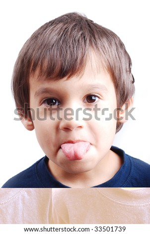 Kid with his tongue outside the mouth - stock photo