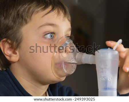 kid with mask for inhalations - stock photo
