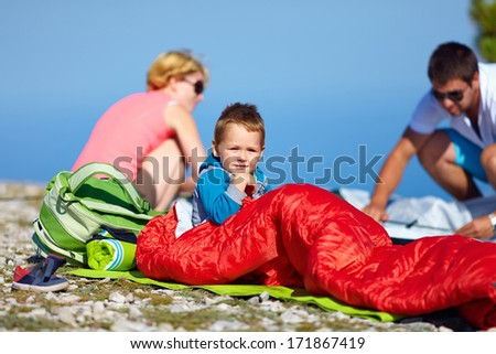 kid with parents camping in mountains - stock photo