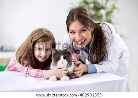 Kid with pet cat at the veterinary doctor - stock photo