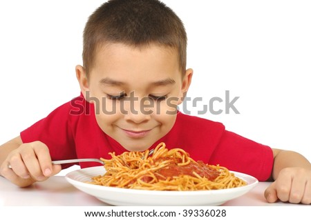 kid with plate of spaghetti and sauce, isolated on white background - stock photo
