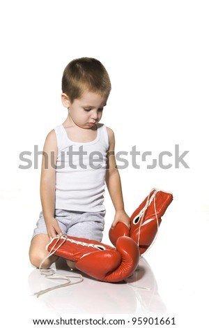 Kid with red boxing gloves isolated on white background - stock photo