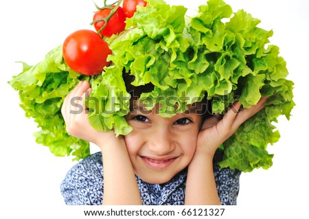 Kid with salad and tomato hat on his head, fake hair made of vegetables - stock photo