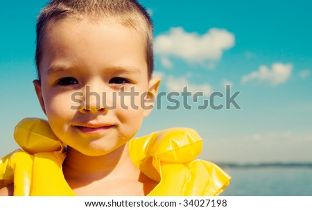 Kid with swimming vest - stock photo