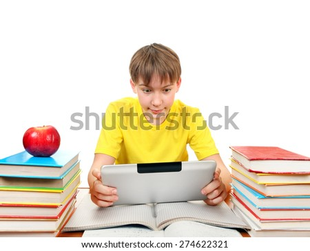 Kid with Tablet Computer at the Desk with the Books on the White Background - stock photo